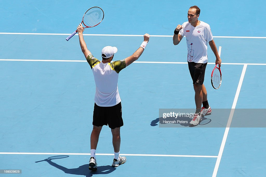 Colin Fleming of Great Britain celebrates with Bruno Soares of Brazil celebrate winning the doubles final against Johan Brunstrom of Sweeden and Frederik Nielsen of Denmark at ASB Tennis Centre on January 12, 2013 in Auckland, New Zealand.