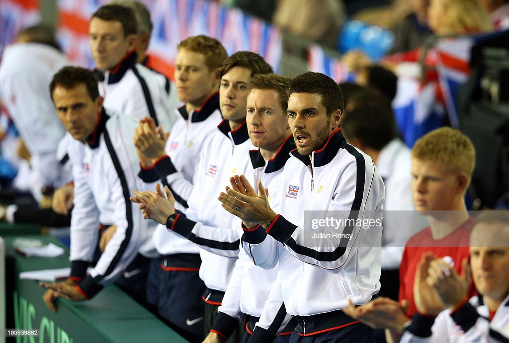 Colin Fleming of Great Britain leads the support forJames Ward of Great Britain in his match against Dmitry Tursunov of Russia during day three of the Davis Cup match between Great Britain and Russia at the Ricoh Arena on April 7, 2013 in Coventry, England.
