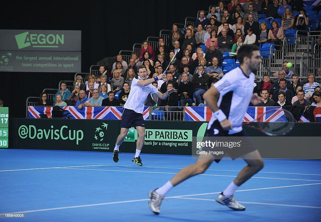 Colin Flemming (R) and Jonny Marray of Great Britain in action against Victor Baluda and Igor Kunitsyn of Russia during day two of the Davis Cup match between Great Britain and Russia at Ricoh Arena on April 6, 2013 in Coventry, England.