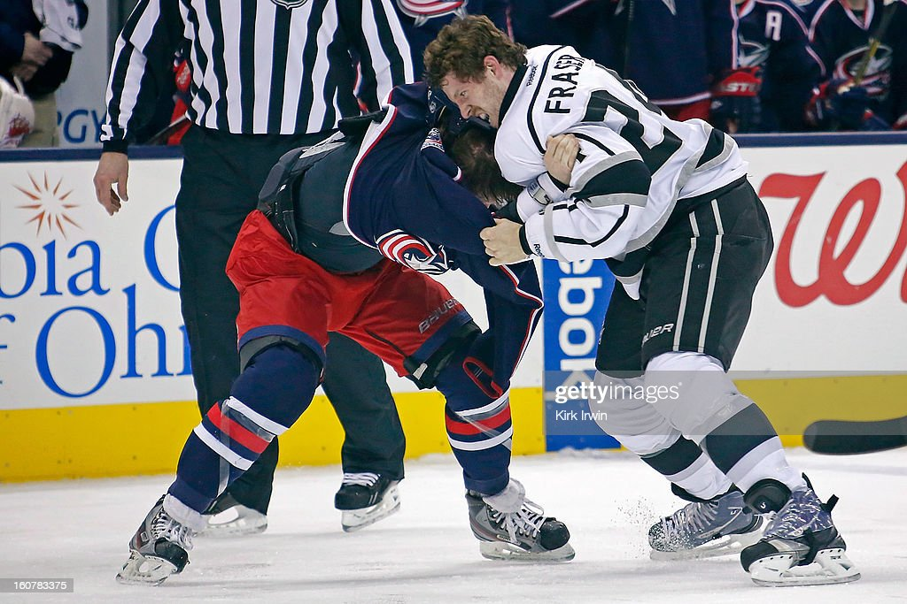 Colin Fraser #24 of the Los Angeles Kings attempts to pull the jersey over the head of Derek Dorsett #15 of the Columbus Blue Jackets during a fight in the second period on February 5, 2013 at Nationwide Arena in Columbus, Ohio.