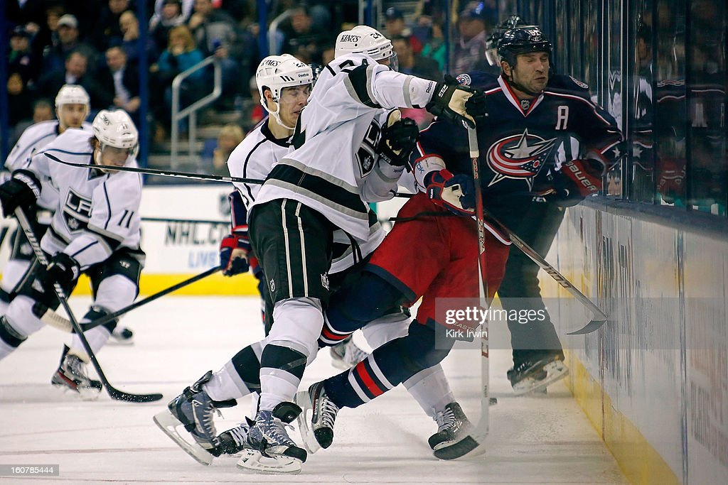 Colin Fraser #24 of the Los Angeles Kings checks Fedor Tyutin #51 of the Columbus Blue Jackets into the boards during the third period on February 5, 2013 at Nationwide Arena in Columbus, Ohio. Los Angeles defeated Columbus 4-2.