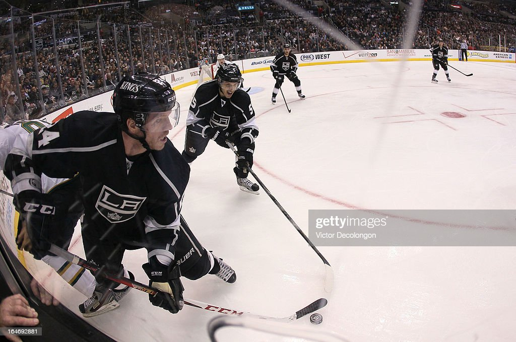 Colin Fraser #24 of the Los Angeles Kings controls the puck in the corner during the NHL game against the Los Angeles Kings at Staples Center on March 21, 2013 in Los Angeles, California. The Stars defeated the Kings 2-0.