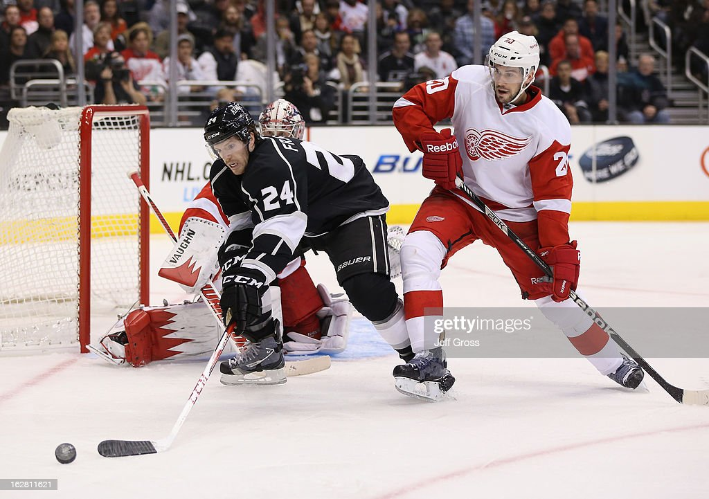 <a gi-track='captionPersonalityLinkClicked' href=/galleries/search?phrase=Colin+Fraser&family=editorial&specificpeople=2225768 ng-click='$event.stopPropagation()'>Colin Fraser</a> #24 of the Los Angeles Kings is pursued by Drew Miller #20 of the Detroit Red Wings for the puck in the second period at Staples Center on February 27, 2013 in Los Angeles, California. The Kings defeated the Red Wings 2-1.