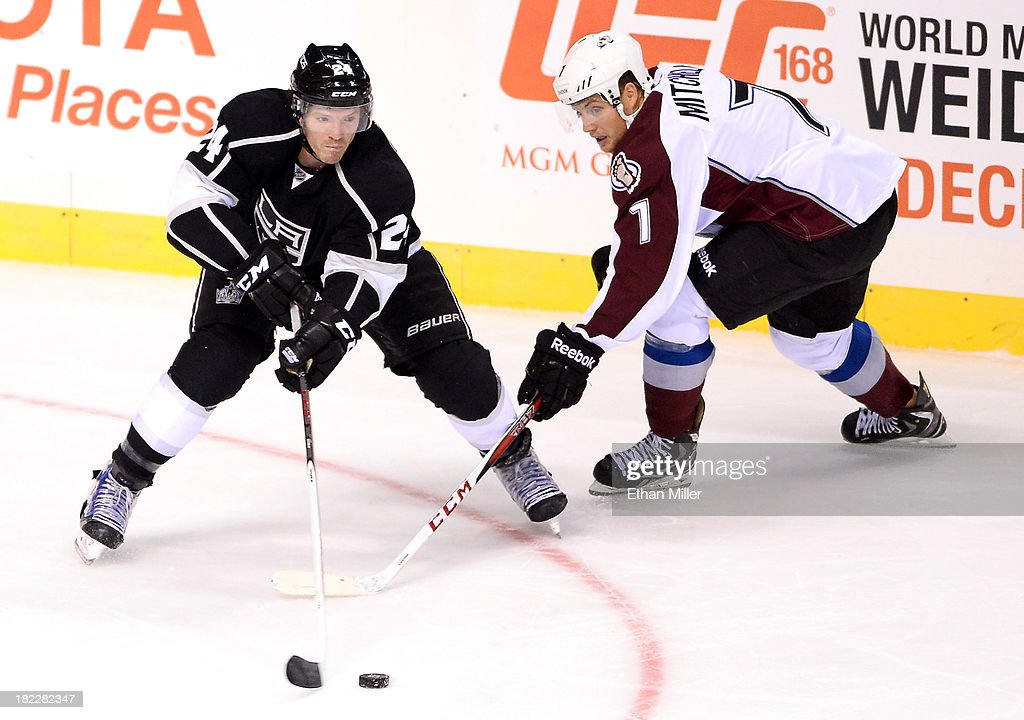 <a gi-track='captionPersonalityLinkClicked' href=/galleries/search?phrase=Colin+Fraser&family=editorial&specificpeople=2225768 ng-click='$event.stopPropagation()'>Colin Fraser</a> #24 of the Los Angeles Kings passes the puck around John Mitchell #7 of the Colorado Avalanche during their preseason game at the MGM Grand Garden Arena on September 28, 2013 in Las Vegas, Nevada. Colorado won 3-2.