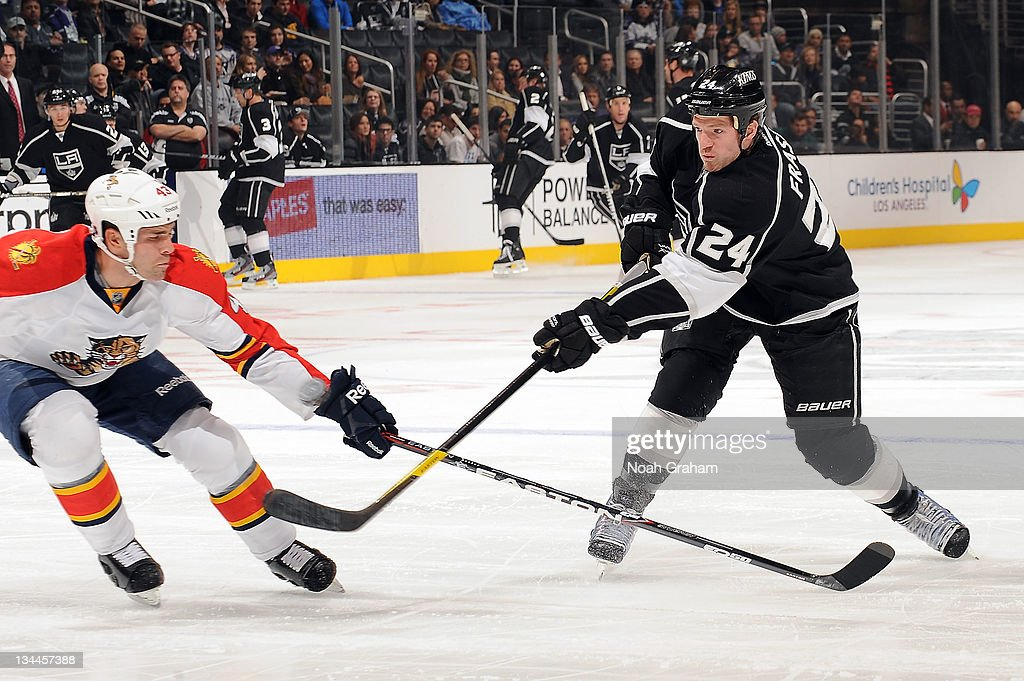 Colin Fraser #24 of the Los Angeles Kings shoots the puck against Mike Weaver #43 of the Florida Panthers at Staples Center on December 1, 2011 in Los Angeles, California.