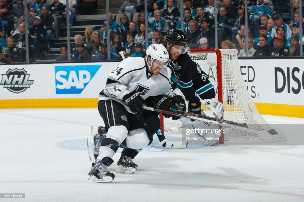 <a gi-track='captionPersonalityLinkClicked' href=/galleries/search?phrase=Colin+Fraser&family=editorial&specificpeople=2225768 ng-click='$event.stopPropagation()'>Colin Fraser</a> #24 of the Los Angeles Kings skates after the puck against <a gi-track='captionPersonalityLinkClicked' href=/galleries/search?phrase=Brad+Stuart+-+Ice+Hockey+Player&family=editorial&specificpeople=213995 ng-click='$event.stopPropagation()'>Brad Stuart</a> #7 of the San Jose Sharks in Game Four of the Western Conference Semifinals during the 2013 Stanley Cup Playoffs at HP Pavilion on May 21 2013 in San Jose, California. The Sharks defeated the Kings 2-1.