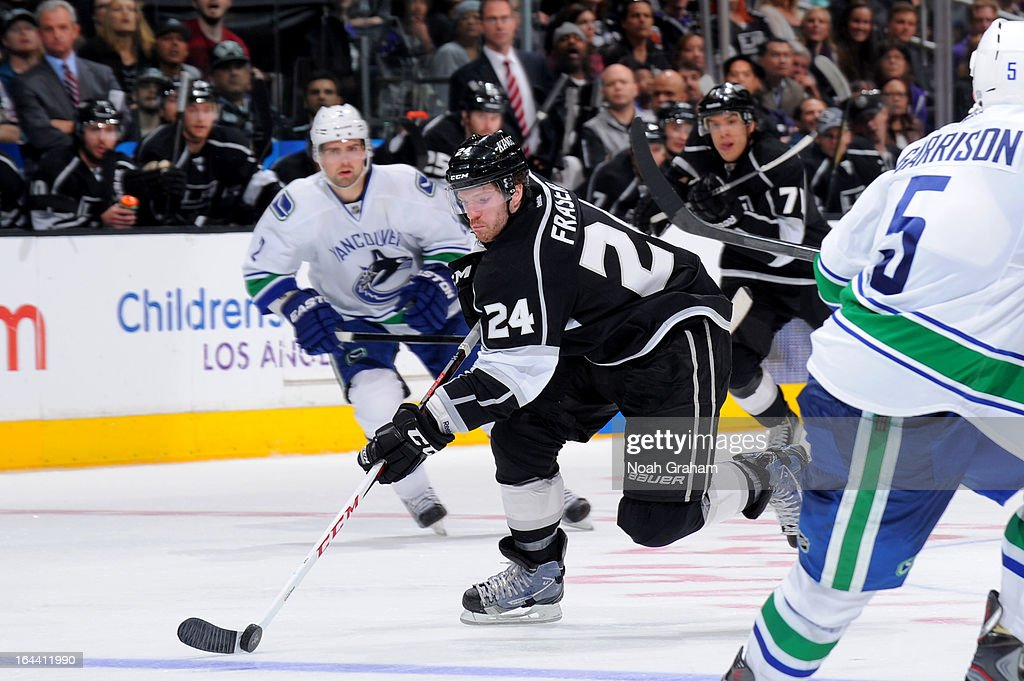 Colin Fraser #24 of the Los Angeles Kings skates with the puck against the Vancouver Canucks at Staples Center on March 23, 2013 in Los Angeles, California.