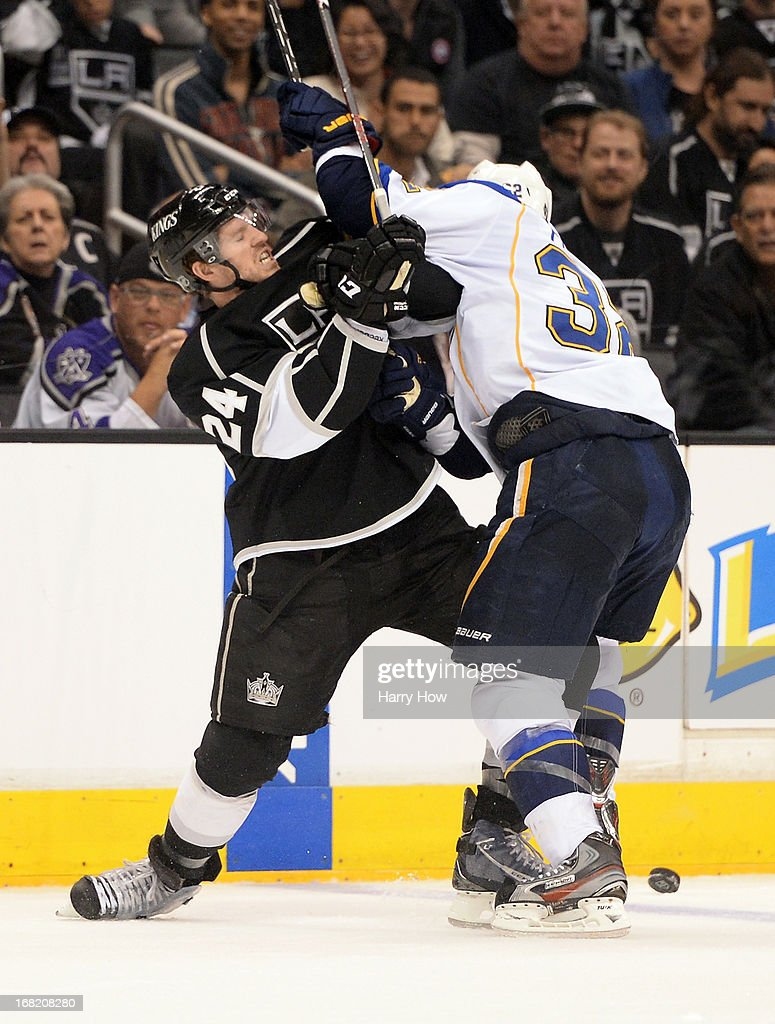 <a gi-track='captionPersonalityLinkClicked' href=/galleries/search?phrase=Colin+Fraser&family=editorial&specificpeople=2225768 ng-click='$event.stopPropagation()'>Colin Fraser</a> #24 of the Los Angeles Kings stands up to Chris Porter #32 of the St. Louis Blues during the second period in Game Four of the Western Conference Quarterfinals during the 2013 NHL Stanley Cup Playoffs at Staples Center on May 6, 2013 in Los Angeles, California.