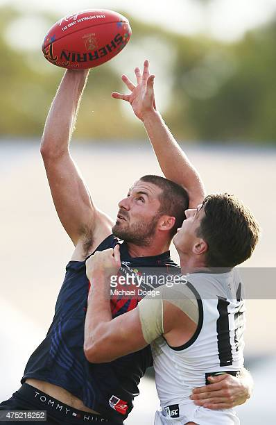 Colin Garland of the Demons competes for the ball with Paul Stewart of the Power during the round nine AFL match between the Melbourne Demons and the...