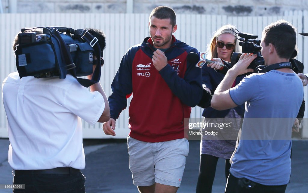 Colin Garland of the Demons is seen walking with media cameras following him during a camp for Melbourne Demons AFL players and coaching staff at Sorrento on April 10, 2013 in Melbourne, Australia.