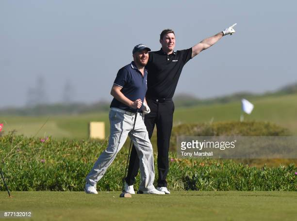 Colin Greenhill Golfplan Commercial Director and Ross Parker PGA Head of Sponsorship watch the shot of James Holmes SkyCaddie UK and European Sales...