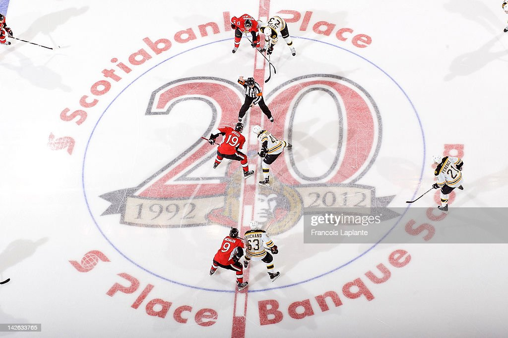 Colin Greening Jason Spezza and Milan Michalek of the Ottawa Senators prepare for a faceoff at center ice against Chris Kelly Rich Peverley Brad...