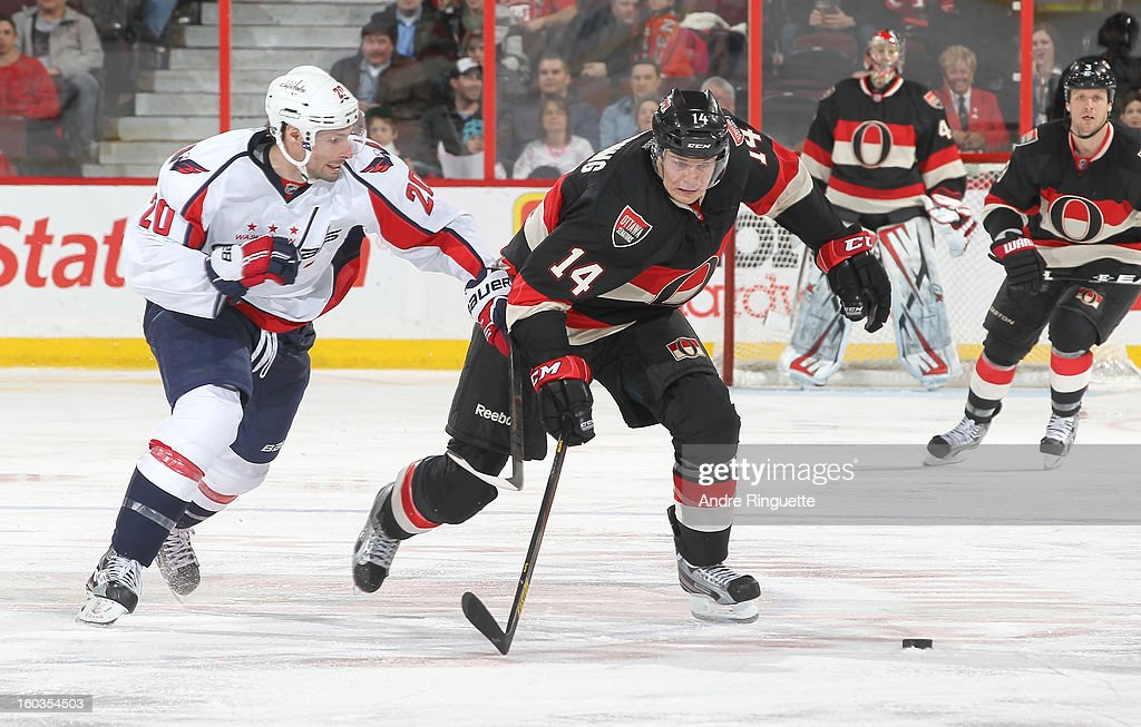 <a gi-track='captionPersonalityLinkClicked' href=/galleries/search?phrase=Colin+Greening&family=editorial&specificpeople=7183741 ng-click='$event.stopPropagation()'>Colin Greening</a> #14 of the Ottawa Senators battles against <a gi-track='captionPersonalityLinkClicked' href=/galleries/search?phrase=Troy+Brouwer&family=editorial&specificpeople=4155305 ng-click='$event.stopPropagation()'>Troy Brouwer</a> #20 of the Washington Capitals on January 29, 2013 at Scotiabank Place in Ottawa, Ontario, Canada.