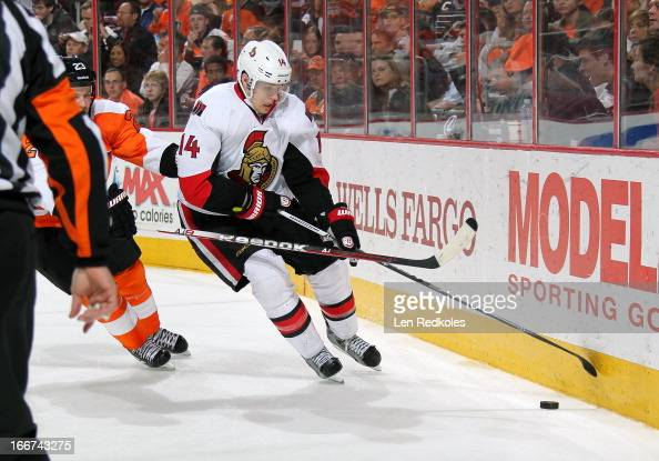 Colin Greening of the Ottawa Senators battles for the puck against Kent Huskins of the Philadelphia Flyers on April 11 2013 at the Wells Fargo Center...