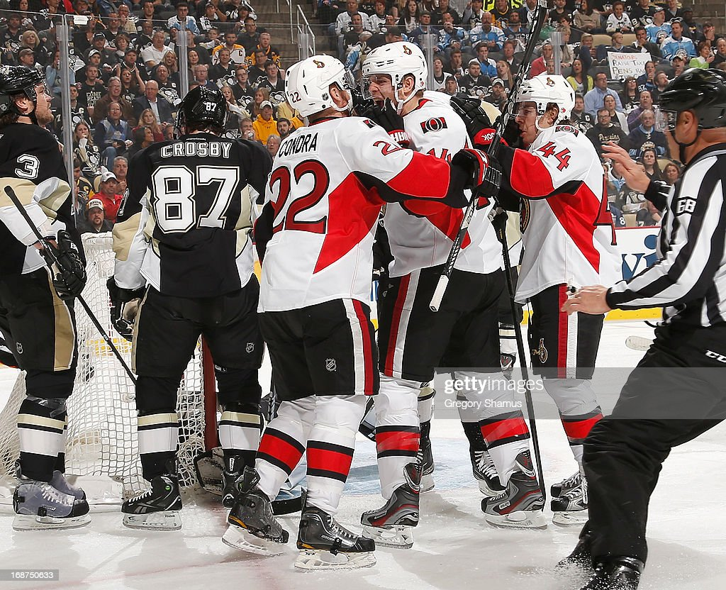 Colin Greening #14 of the Ottawa Senators celebrates his goal with Erik Condra #22 and Jean-Gabriel Pageau #44 during the first period against the Ottawa Senators in Game One of the Eastern Conference Semifinals during the 2013 NHL Stanley Cup Playoffs at Consol Energy Center on May 14, 2013 in Pittsburgh, Pennsylvania.