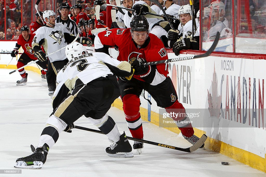<a gi-track='captionPersonalityLinkClicked' href=/galleries/search?phrase=Colin+Greening&family=editorial&specificpeople=7183741 ng-click='$event.stopPropagation()'>Colin Greening</a> #14 of the Ottawa Senators controls the puck against <a gi-track='captionPersonalityLinkClicked' href=/galleries/search?phrase=Matt+Niskanen&family=editorial&specificpeople=2106633 ng-click='$event.stopPropagation()'>Matt Niskanen</a> #2 of the Pittsburgh Penguins in Game Three of the Eastern Conference Semifinals during the 2013 NHL Stanley Cup Playoffs at Scotiabank Place on May 19, 2013 in Ottawa, Ontario, Canada.