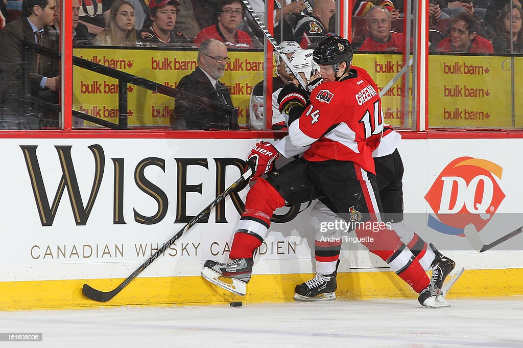 <a gi-track='captionPersonalityLinkClicked' href=/galleries/search?phrase=Colin+Greening&family=editorial&specificpeople=7183741 ng-click='$event.stopPropagation()'>Colin Greening</a> #14 of the Ottawa Senators gets tangled with <a gi-track='captionPersonalityLinkClicked' href=/galleries/search?phrase=Tom+Kostopoulos&family=editorial&specificpeople=209030 ng-click='$event.stopPropagation()'>Tom Kostopoulos</a> #25 of the New Jersey Devils along the boards while battling for puck possession on March 25, 2013 at Scotiabank Place in Ottawa, Ontario, Canada.