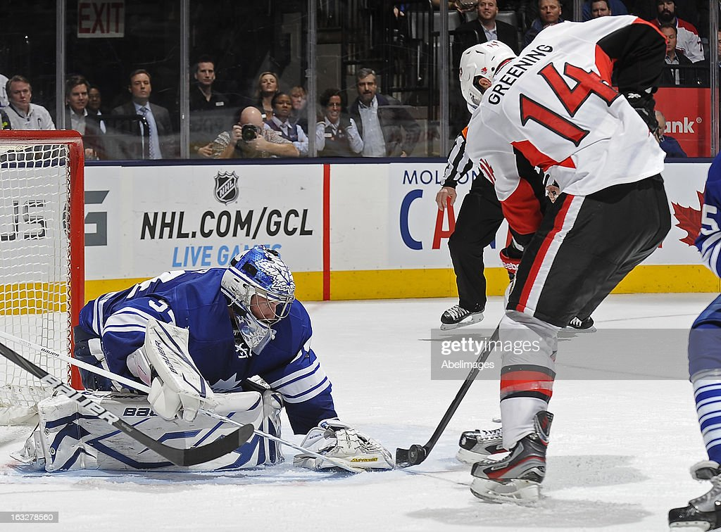 <a gi-track='captionPersonalityLinkClicked' href=/galleries/search?phrase=Colin+Greening&family=editorial&specificpeople=7183741 ng-click='$event.stopPropagation()'>Colin Greening</a> #14 of the Ottawa Senators is stopped in close by James Reimer #34 of the Toronto Maple Leafs during NHL game action March 6, 2013 at the Air Canada Centre in Toronto, Ontario, Canada.