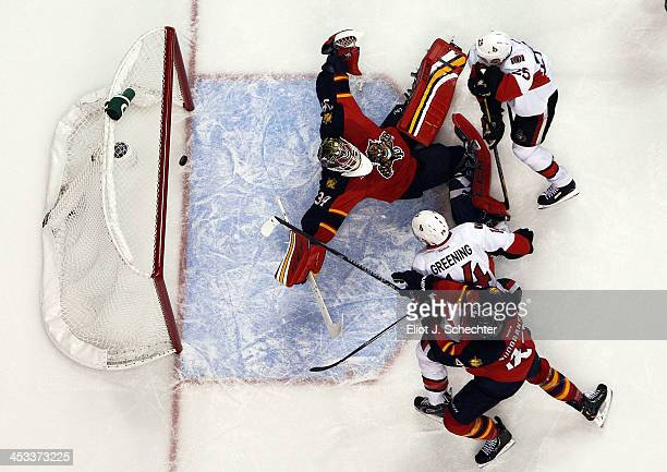 Colin Greening of the Ottawa Senators scores a goal against Goaltender Tim Thomas of the Florida Panthers at the BBT Center on December 3 2013 in...