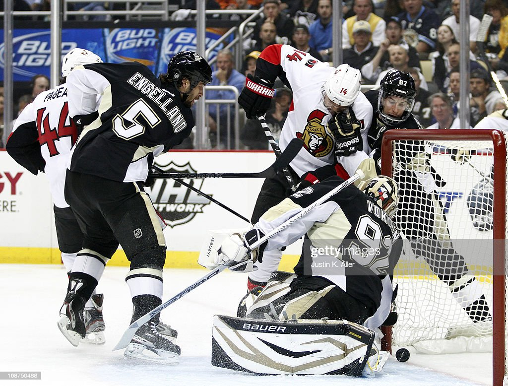 Colin Greening #14 of the Ottawa Senators scores past Tomas Vokoun #92 of the Pittsburgh Penguins in Game One of the Eastern Conference Semifinals during the 2013 NHL Stanley Cup Playoffs at Consol Energy Center on May 14, 2013 in Pittsburgh, Pennsylvania.