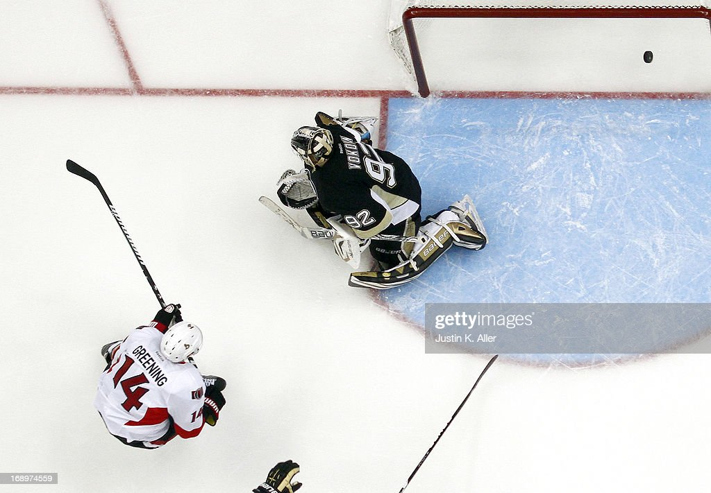 <a gi-track='captionPersonalityLinkClicked' href=/galleries/search?phrase=Colin+Greening&family=editorial&specificpeople=7183741 ng-click='$event.stopPropagation()'>Colin Greening</a> #14 of the Ottawa Senators scores past <a gi-track='captionPersonalityLinkClicked' href=/galleries/search?phrase=Tomas+Vokoun&family=editorial&specificpeople=202179 ng-click='$event.stopPropagation()'>Tomas Vokoun</a> #92 of the Pittsburgh Penguins in the second period in Game Two of the Eastern Conference Semifinals during the 2013 NHL Stanley Cup Playoffs at Consol Energy Center on May 17, 2013 in Pittsburgh, Pennsylvania. The Penguins defeated the Senators 4-3.