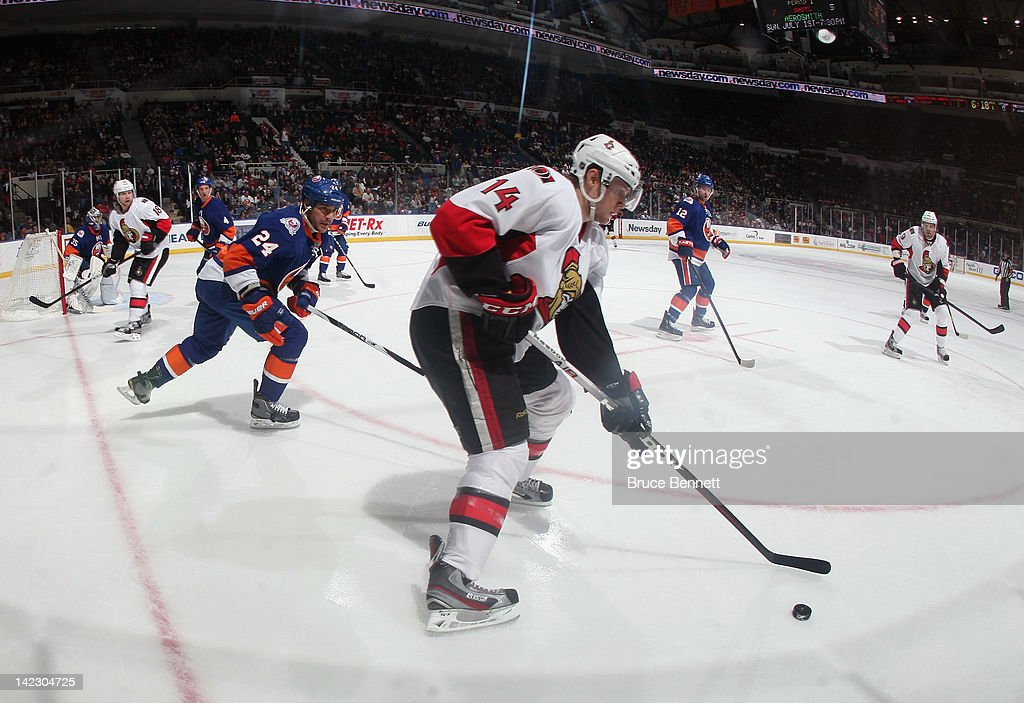 <a gi-track='captionPersonalityLinkClicked' href=/galleries/search?phrase=Colin+Greening&family=editorial&specificpeople=7183741 ng-click='$event.stopPropagation()'>Colin Greening</a> #14 of the Ottawa Senators skates against the New York Islanders at the Nassau Veterans Memorial Coliseum on April 1, 2012 in Uniondale, New York.