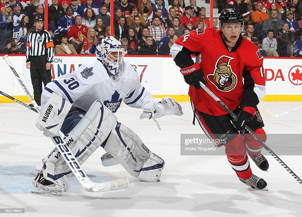 <a gi-track='captionPersonalityLinkClicked' href=/galleries/search?phrase=Colin+Greening&family=editorial&specificpeople=7183741 ng-click='$event.stopPropagation()'>Colin Greening</a> #14 of the Ottawa Senators skates in front of <a gi-track='captionPersonalityLinkClicked' href=/galleries/search?phrase=Ben+Scrivens&family=editorial&specificpeople=7185205 ng-click='$event.stopPropagation()'>Ben Scrivens</a> #30 of the Toronto Maple Leafs on February 23, 2013 at Scotiabank Place in Ottawa, Ontario, Canada.