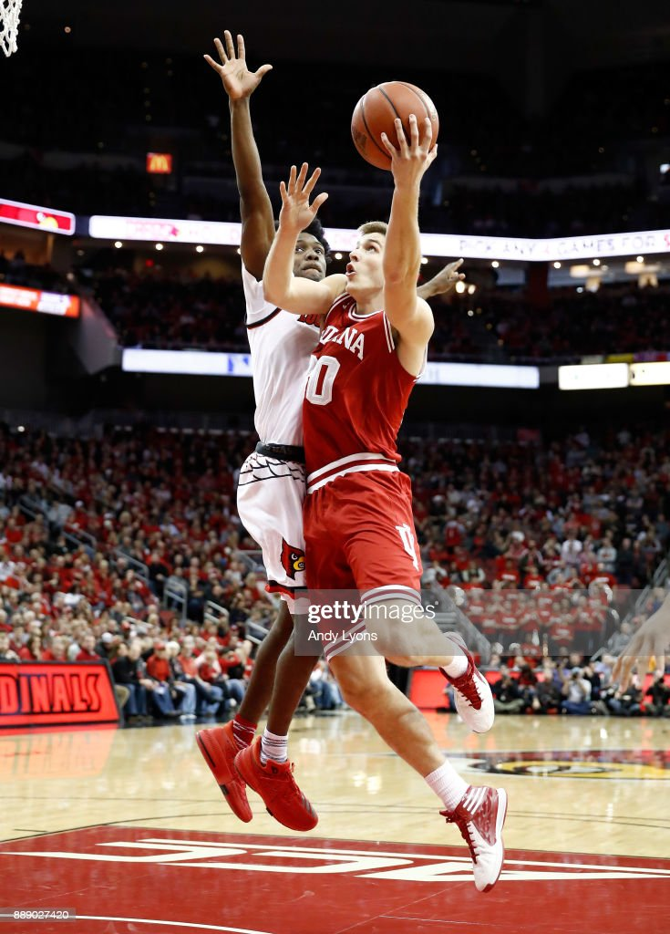 Colin Hartman #30 of the Indiana Hoosiers shoots the ball against the Louisville Cardinals at KFC YUM! Center on December 9, 2017 in Louisville, Kentucky.