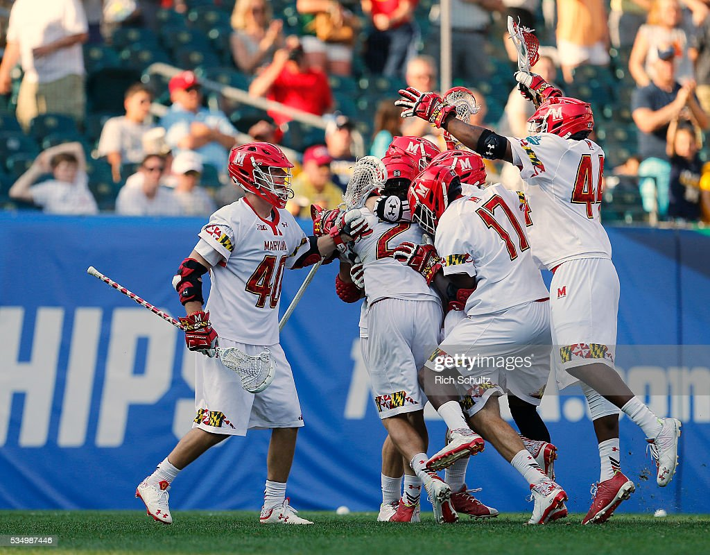 Colin Heacock #2 of the Maryland Terrapins is mobbed by teammates after his game winning goal in overtime for a 15-14 win over the Brown Bears during a semi final match in the NCAA Division I Men's Lacrosse Championship at Lincoln Financial Field on May 28, 2016 in Philadelphia, Pennsylvania.