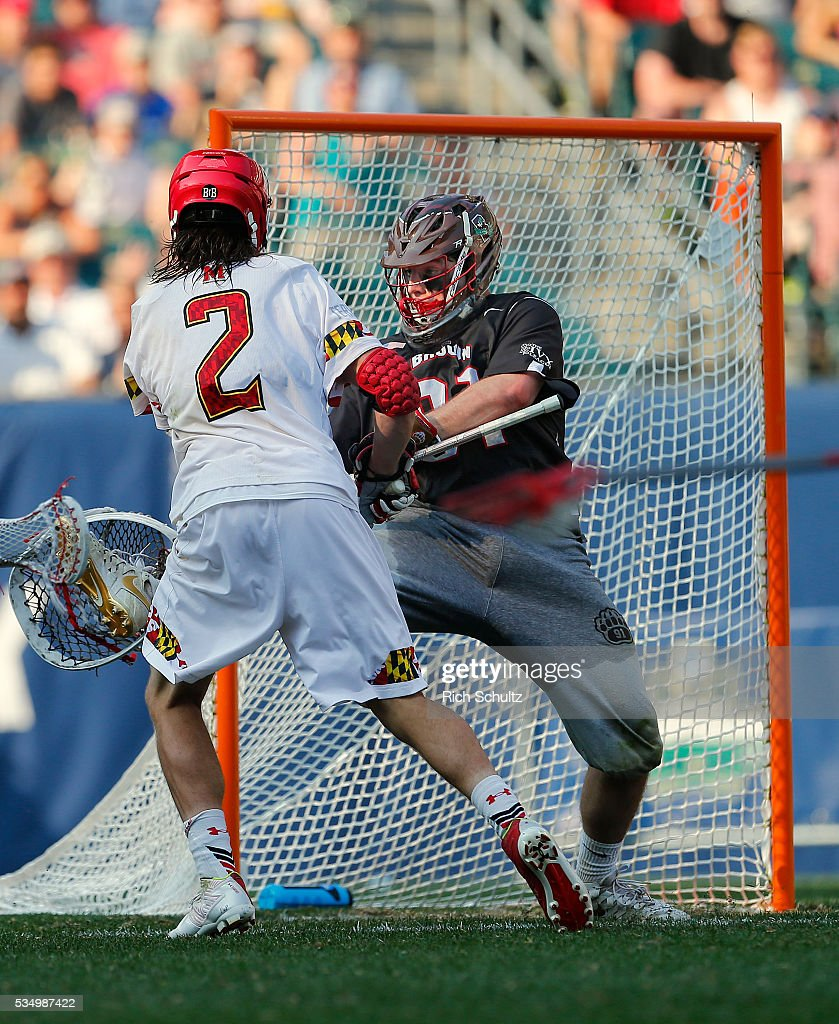 Colin Heacock #2 of the Maryland Terrapins scores the game winning goal in overtime past goalie Jack Kelly #91 of the Brown Bears during a semi final match in the NCAA Division I Men's Lacrosse Championship at Lincoln Financial Field on May 28, 2016 in Philadelphia, Pennsylvania. Maryland won 15-14.
