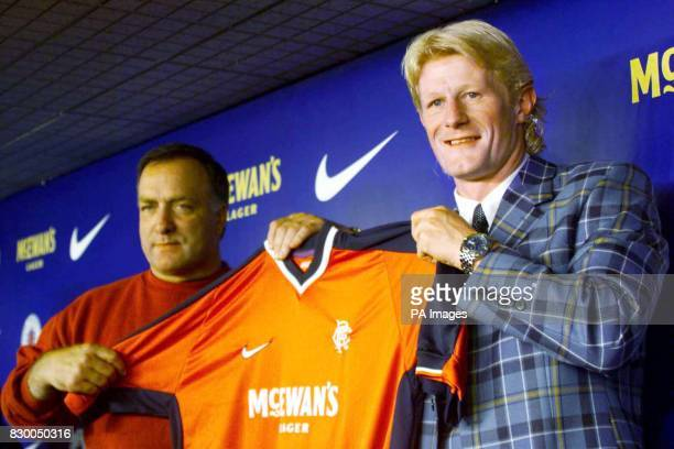 Colin Hendry and Ranger's manager Dick Advocaat hold up a Ranger's shirt after he signed with the club today from Blackburn EDI Photo by Chris...