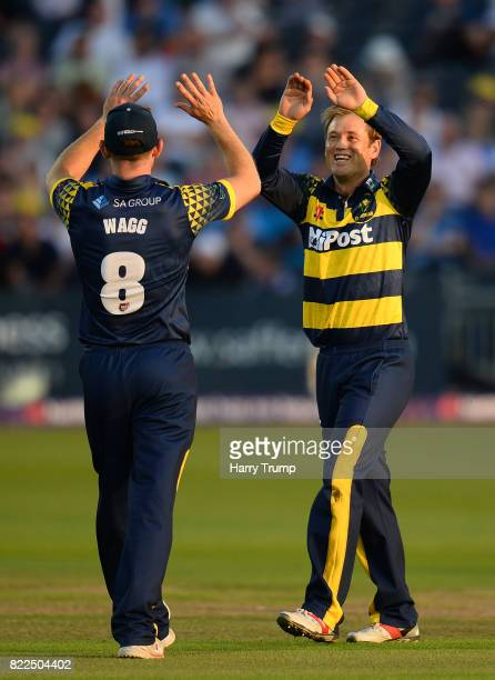 Colin Ingram and Graham Wagg of Glamorgan celebrate the wicket of George Hankins of Gloucestershire during the NatWest T20 Blast match between...