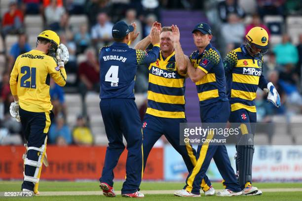 Colin Ingram of Glamorgan celebrates after taking the wicket of Calvin Dickinson of Hampshire during the NatWest T20 Blast match between Hampshire...