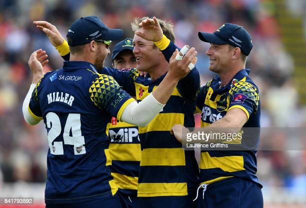 Colin Ingram of Glamorgan celebrates with team mates after dismissing Dominic Sibley of Birmingham during the NatWest T20 Blast SemiFinal match...