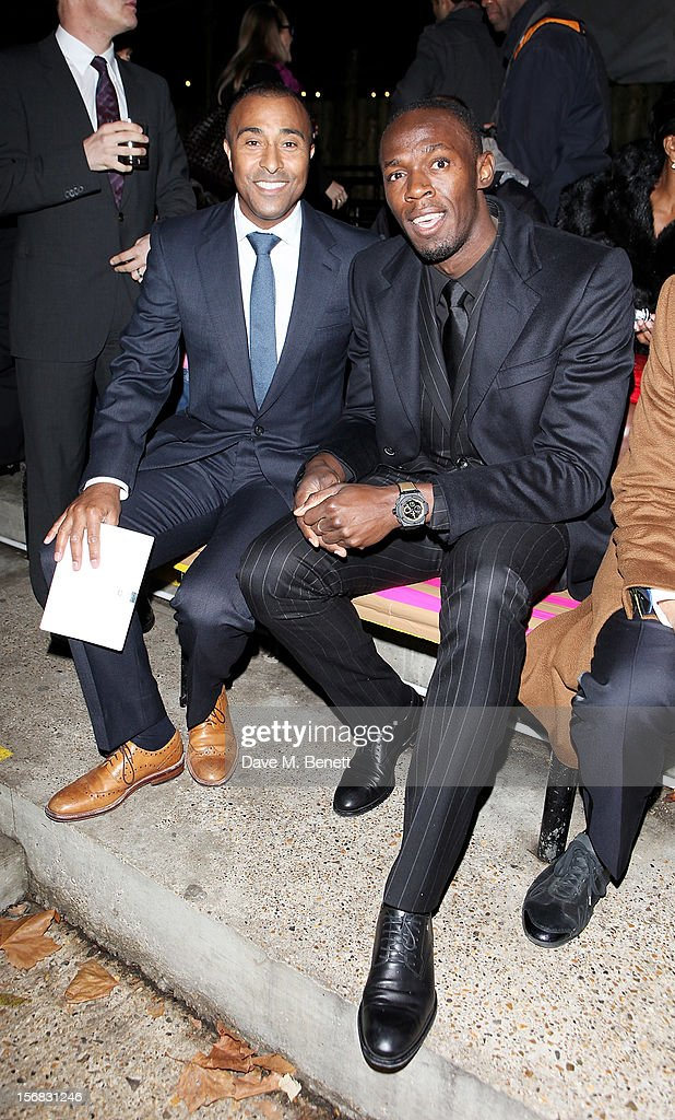 Colin Jackson (L) and Usain Bolt arrive at the Zeitz Foundation and ZSL Gala at London Zoo on November 22, 2012 in London, England.