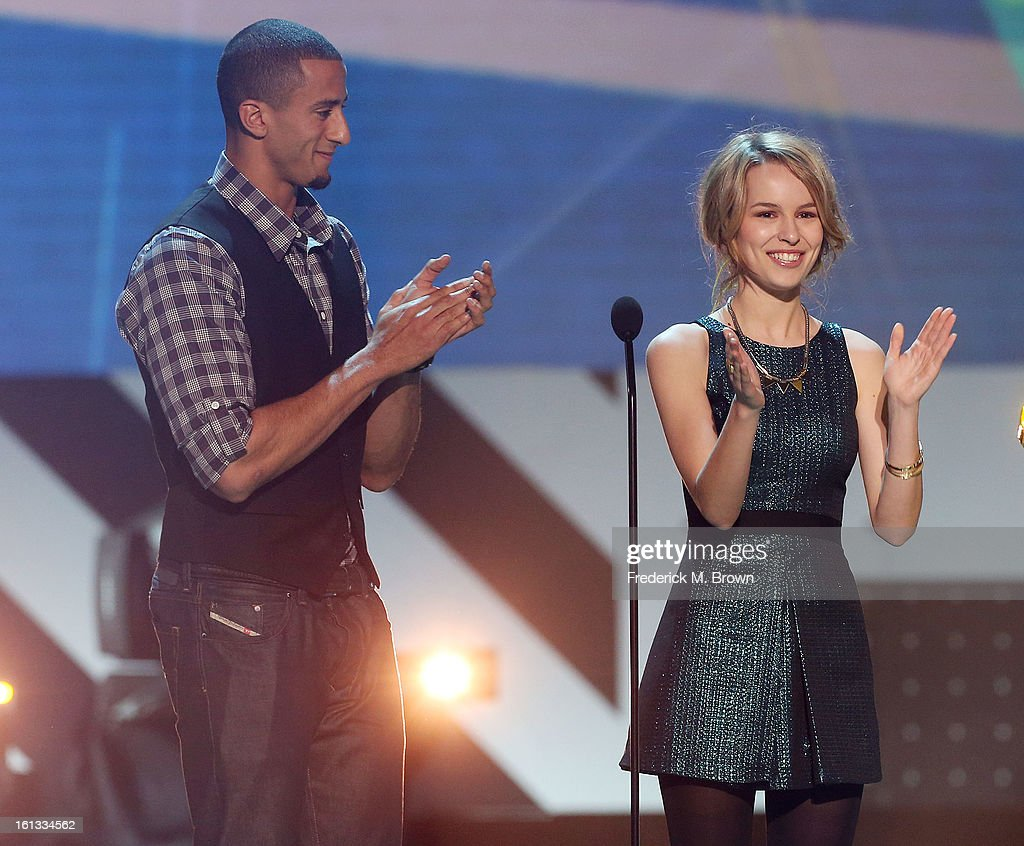Colin Kaepernick (L) and Bridgit Mendler speak during the 3rd Annual Cartoon Network's 'Hall Of Fame' Awards at the Barker Hangar, Santa Monica Airport, on February 9, 2013 in Santa Monica, California.