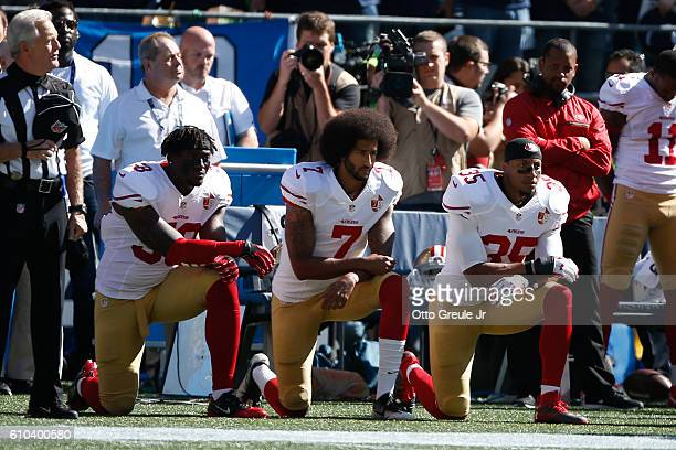 Colin Kaepernick and members of the San Francisco 49ers kneel during the national anthem prior to the game against the Seattle Seahawks at...