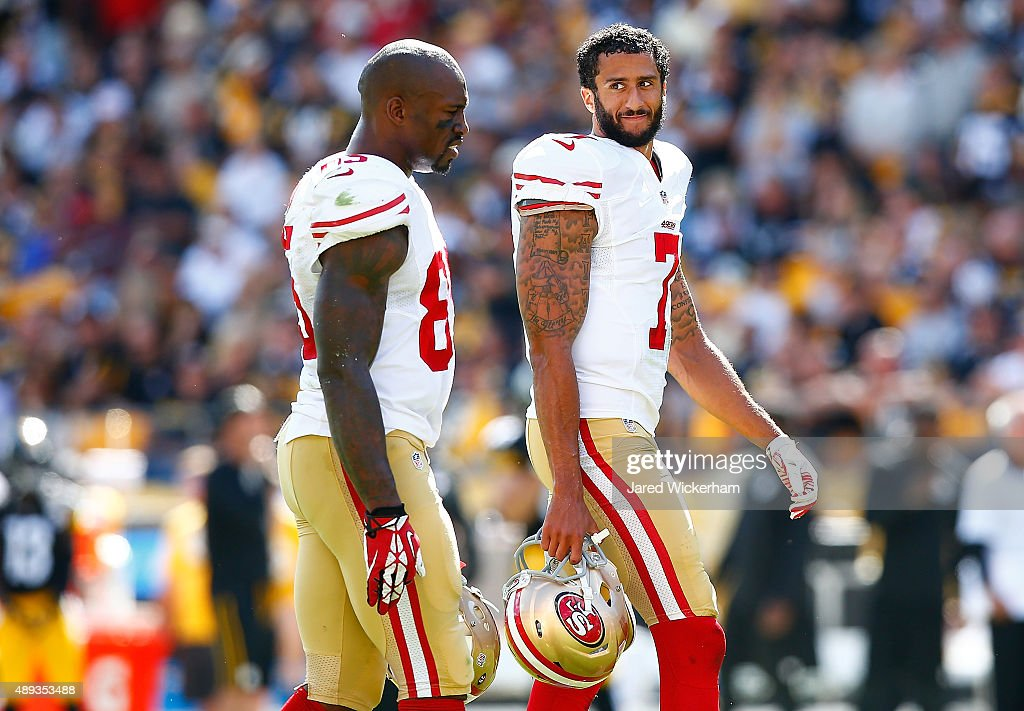 Colin Kaepernick and Vernon Davis of the San Francisco 49ers talk during a timeout against the Pittsburgh Steelers during the game at Heinz Field on...