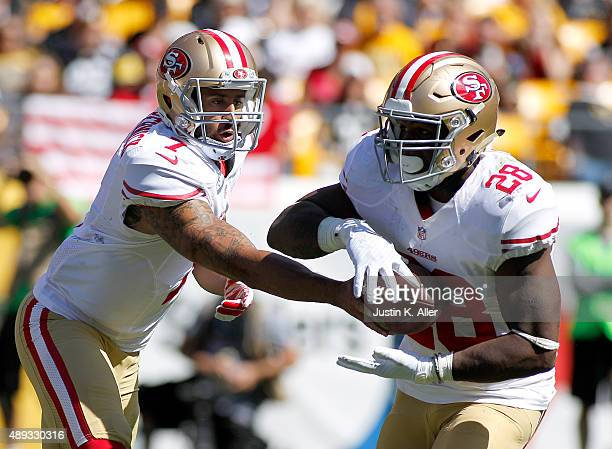 Colin Kaepernick hands off to Carlos Hyde of the San Francisco 49ers in the second quarter during the game against the Pittsburgh Steelers on...