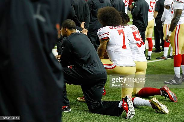 Colin Kaepernick of the San Francisco 49ers and Eli Harold kneel during the National Anthem prior to the game against the Atlanta Falcons at the...