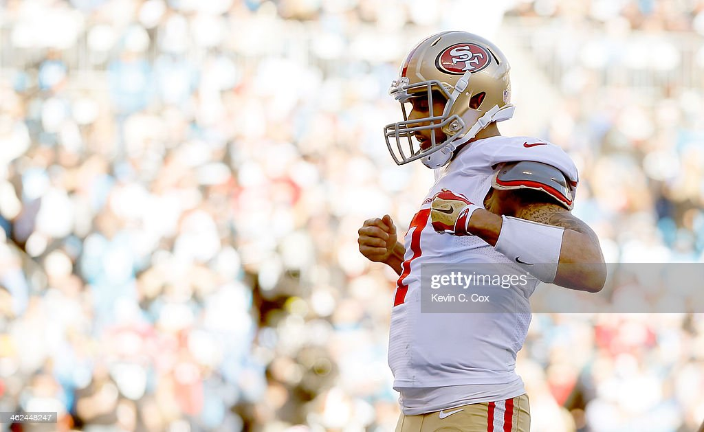 <a gi-track='captionPersonalityLinkClicked' href=/galleries/search?phrase=Colin+Kaepernick&family=editorial&specificpeople=5525694 ng-click='$event.stopPropagation()'>Colin Kaepernick</a> #7 of the San Francisco 49ers celebrates after a touchdown in the third quarter against the Carolina Panthers during the NFC Divisional Playoff Game at Bank of America Stadium on January 12, 2014 in Charlotte, North Carolina.
