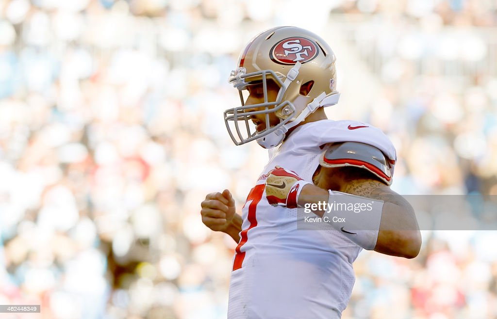 Colin Kaepernick of the San Francisco 49ers celebrates after a touchdown in the third quarter against the Carolina Panthers during the NFC Divisional...