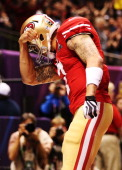 Colin Kaepernick of the San Francisco 49ers celebrates after he scored a 15yard rushing touchdown in the fourth quarter against the Baltimore Ravens...