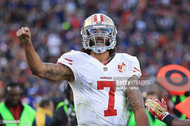 Colin Kaepernick of the San Francisco 49ers celebrates after scoring a touchdown during the fourth quarter against the Los Angeles Rams at Los...