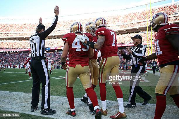 Colin Kaepernick of the San Francisco 49ers celebrates with Bruce Miller of the San Francisco 49ers after a touchdown in the third quarter against...