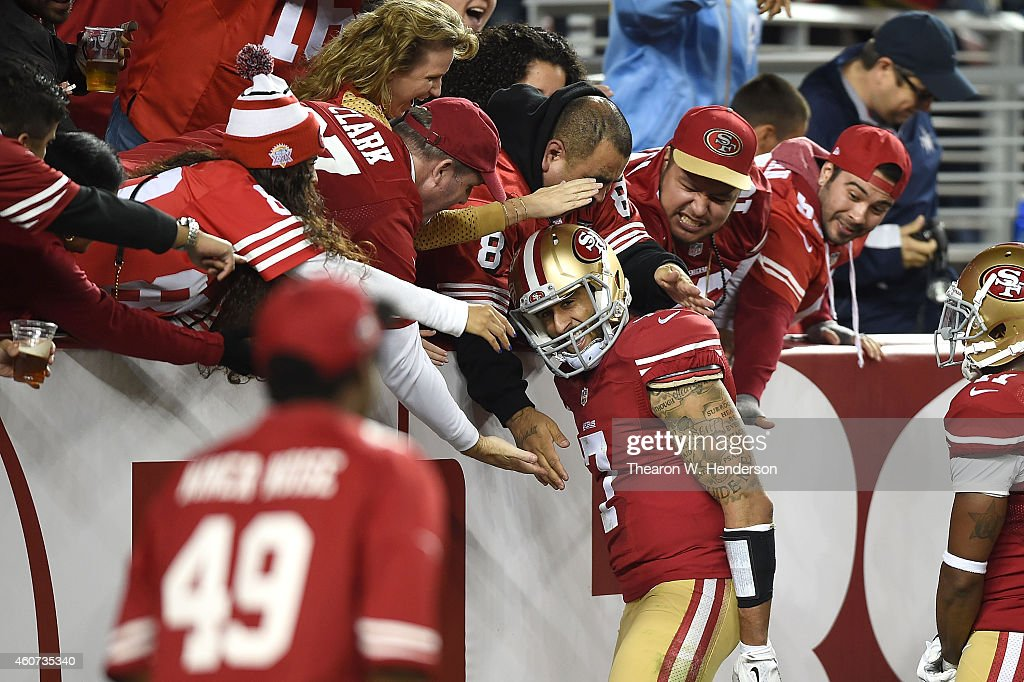 Colin Kaepernick of the San Francisco 49ers celebrates with fans after a 90 yard touchdown in the third quarter against the San Diego Chargers at...