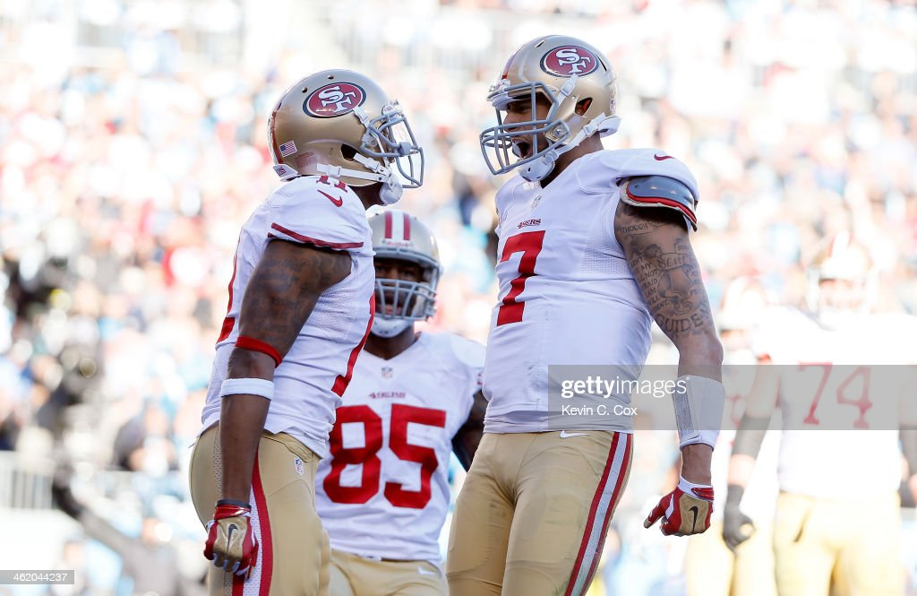 <a gi-track='captionPersonalityLinkClicked' href=/galleries/search?phrase=Colin+Kaepernick&family=editorial&specificpeople=5525694 ng-click='$event.stopPropagation()'>Colin Kaepernick</a> #7 of the San Francisco 49ers celebrates with <a gi-track='captionPersonalityLinkClicked' href=/galleries/search?phrase=Quinton+Patton&family=editorial&specificpeople=9703993 ng-click='$event.stopPropagation()'>Quinton Patton</a> #11 after a touchdown in the third quarter against the Carolina Panthers during the NFC Divisional Playoff Game at Bank of America Stadium on January 12, 2014 in Charlotte, North Carolina.