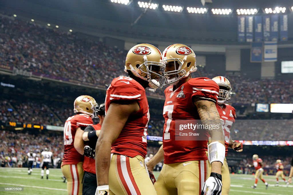 Colin Kaepernick of the San Francisco 49ers celebrates with teammate Michael Crabtree after a touchdown was scored against the Baltimore Ravens...