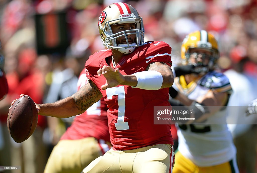 Colin Kaepernick #7 of the San Francisco 49ers drops back to pass during the first quarter against the Green Bay Packers at Candlestick Park on September 8, 2013 in San Francisco, California.