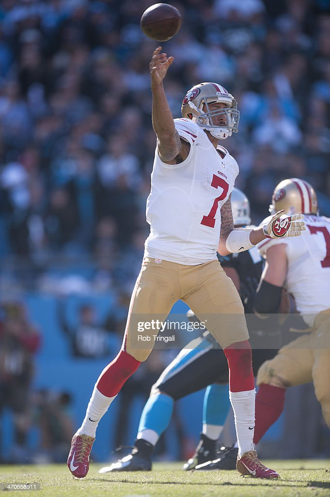 Colin Kaepernick #7 of the San Francisco 49ers drops back to pass during the NFC Divisional Playoff Game against the Carolina Panthers at Bank of America Stadium on January 12, 2014 in Charlotte, North Carolina.